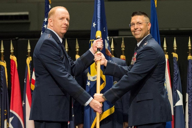 Lt. Gen. Robert D. McMurry, Air Force Life Cycle Management Center commander, passes the guidon to Col. Thomas Sherman as he assumes command of the 88th Air Base Wing during a ceremony inside the National Museum of the United States Air Force at Wright-Patterson Air Force Base June 19. Sherman replaced Col. Bradley McDonald. (U.S. Air Force photo/Wesley Farnsworth)