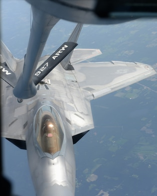 An F-22A Raptor assigned to Tyndall Air Force Base, Fla., prepares to be refueled by a KC-135 Stratotanker aircraft assigned to MacDill Air Force Base, Fla, June 18, 2018.