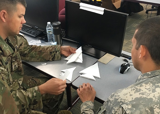 U.S. Army Soldiers work a problem-solving exercise while attending the Common Faculty Development Instructor Course hosted by 4th Battalion, 218th Regiment (Leadership), South Carolina National Guard, at the McCrady Training Center in Eastover, South Carolina, June 6, 2018.
