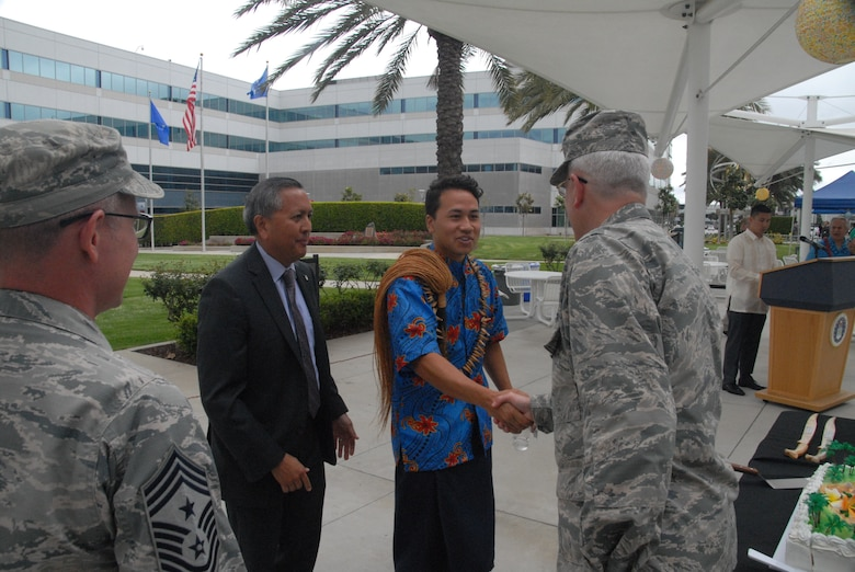 """Brig. Gen. Philip A. Garrant, SMC vice commander, Chief  Master Sgt. Scott A. Myers, SMC Command Chief, and Mr. Cordell A. DeLaPena, director of SMC's Program Management and Integration Directorate, say """"Talofa"""" (Hello) to Charles Ulualofaiga Coleman II, after his opening remarks at the 25th annual Asian Pacific Islander Heritage Celebration."""