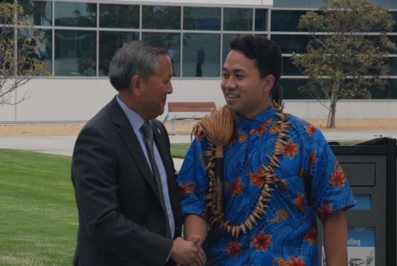 """Mr. Cordell A. DeLaPena, director of SMC's Program Management and Integration Directorate, congratulates Charles Ulualofaiga Coleman II, the first Associated Student of Loyola Marymount University president and a native Hawaiian with Samoan heritage for singing """"""""Lo Ta Nu""""u"""""""" - (My Dear Island Nation) during the 25th anniversary of Asian American Pacific Islander Heritage Month at Los Angeles Air Force Base"""