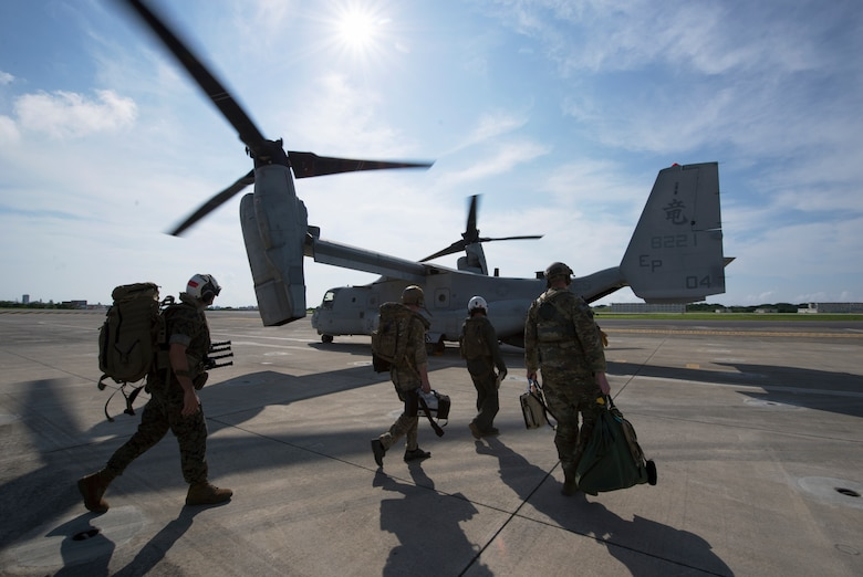Members of the U.S. Air Force, Navy and Marines, board an MV-22 Osprey June 6, 2018, at Marine Corps Air Station, Okinawa, Japan during an exercise. The Air Force performs joint medical exercises with other U.S. forces regularly in Okinawa to better prepare service members for real world emergencies. (U.S. Air Force photo by Senior Airman Thomas Barley)