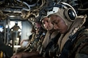 Members of the U.S. Air Force, Navy and Marines, prepare for a medical exercise aboard an MV-22 Osprey, June 6, 2018, at Marine Corps Air Station, Okinawa, Japan. The Air Force performs joint medical exercises with other U.S. forces regularly in Okinawa to better prepare service members for real world emergencies. (U.S. Air Force photo by Senior Airman Thomas Barley)