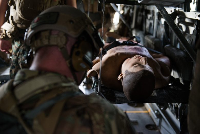 A member of the U.S. Air Force from the 353rd Special Operations Squadron, respond to a simulated casualty during a medical exercise, June 6, 2018, at Camp Hansen, Okinawa, Japan. The Air Force performs joint medical exercises with other U.S. forces regularly in Okinawa to better prepare service members for real world emergencies. (U.S. Air Force photo by Senior Airman Thomas Barley)