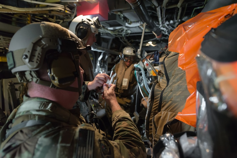 Members of the U.S. Air Force and Navy respond to a simulated casualty during a medical exercise, June 6, 2018, at Camp Hansen, Okinawa, Japan. The Air Force performs joint medical exercises with other U.S. forces regularly in Okinawa to better prepare service members for real world emergencies. (U.S. Air Force photo by Senior Airman Thomas Barley)