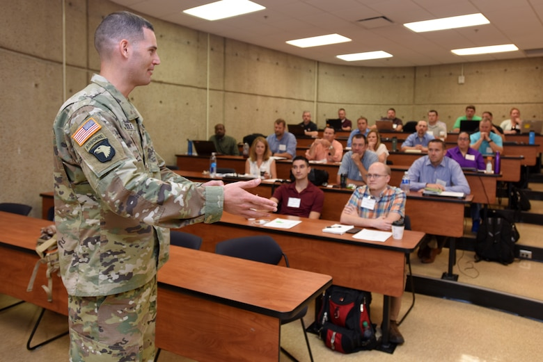 Maj. Justin Toole, U.S. Army Corps of Engineers Nashville District deputy commander, encourages 36 participants of the Hydropower Acquisition Course June 19, 2018 at Tennessee State University's Avon Williams Campus in Nashville, Tenn., to network and freely share expertise.  The purpose of the course is to synchronize best practices and work on improving how the Corps of Engineers executes a hydropower project from cradle to grave. (USACE Photo by Lee Roberts)