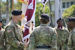 Regional Health Command-Pacific (RHC-P) incoming Commanding General, Brig. Gen. Dennis LeMaster (left), accepts the colors from Army Surgeon General and Commanding General, U.S. Army Medical Command, Lt. Gen. Nadja West (center), along with outgoing RHC-P Commander, Brig. Gen. Bertram Providence (right), during the RHC-P change of command ceremony.