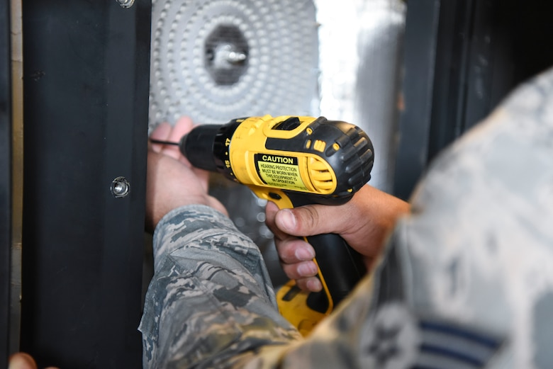 Senior Airman Kristian Martinez-felix, a 319th Civil Engineer Squadron heating, ventilation, air conditioning and refrigeration apprentice unscrews a water boiler June 20, 2018, on Grand Forks Air Force Base, North Dakota. Martinez-Felix unscrews the water boiler so that he can see if it has possible overflow or needs cleaning. (U.S. Air Force photo by Airman 1st Class Melody Wolff)
