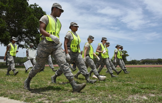 Members of the 81st Force Support Squadron Search and Recovery Team conduct a sweep of the scene during a major accident response exercise near the triangle track at Keesler Air Force Base, Mississippi, June 21, 2018. The exercise scenario simulated a C-130J Super Hercules in-flight emergency causing a plane crash, which resulted in a mass casualty response event. This exercise tested the base's ability to respond in a crisis situation. (U.S. Air Force photo by Kemberly Groue)
