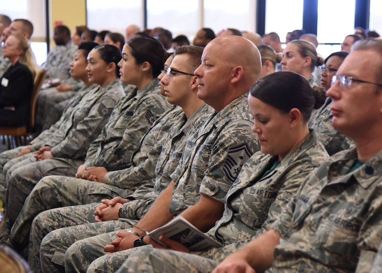 Keesler personnel, families and friends attend the 81st Medical Group change of command ceremony in the Bay Breeze Event Center at Keesler Air Force Base, Mississippi, June 22, 2018. U.S. Air Force Col. Beatrice Dolihite, incoming 81st MDG commander, assumed command from Col. Jeannine Ryder, outgoing 81st MDG commander, with the passing of the guidon. (U.S. Air Force photo by Kemberly Groue)