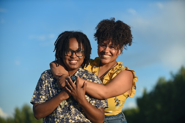 U.S. Air Force Tech. Sgt. Nykita Stoudemire, left, an Air Reserve Personnel Center reserve assignments technician, poses with her wife, Marissa, in Aurora, Colorado, June 21, 2018.