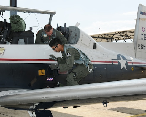 Cadet Bridger Barker, U.S. Air Force Academy, and Capt. Michael Arakawa, 41st Flying Training Squadron instructor pilot, prepare for a T-6A Texan II familiarization flight June 8, 2018, at Columbus Air Force Base, Mississippi. Cadets from the Academy are visited Columbus AFB over the last few weeks as part of the U.S. Air Force Academy Operations Air Force 2018, where they experienced daily life and operations as an officer. (U.S. Air Force photo by Mary Crump)