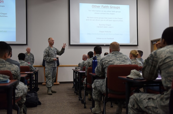 U.S. Air Force Capt. Samuel McClellan, 460th Space Wing chaplain, speaks to members of Team Buckley during a newcomer's orientation at Buckley Air Force Base, Colorado, June 20, 2018.
