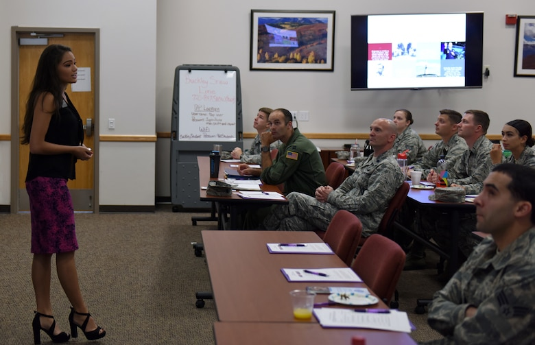 Rachel Gruber, far left, Aurora Chamber of Commerce director of business development and events, speaks to members of Team Buckley during the newcomer's orientation at Buckley Air Force Base, Colorado, June 20, 2018.