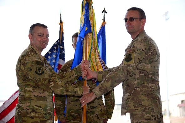 Lt. Col. Bryan Tuinman, right, accepts command of the 40th Helicopter Squadron from Col. Joshua Bowman, 582nd Helicopter Group commander, during an assumption of command ceremony June 22, 2018, at Malmstrom AFB, Mont.