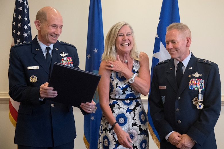 Mike Holmes The Commander Of Air Combat Command Hands A Spouse Appreciation