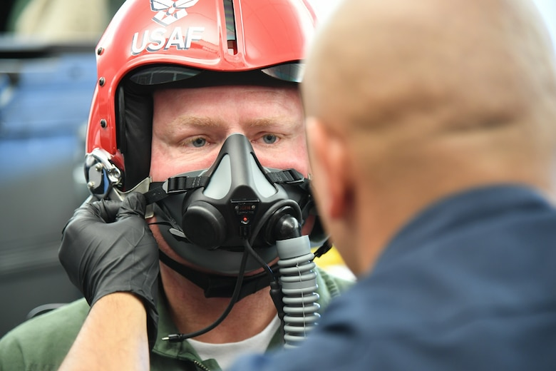 Sergeant Aaron Thompson, Utah Washington County Sheriff, gets fitted for his oxygen mask with the help of  Tech. Sgt. Ed Portan, U.S. Air Force Thunderbirds aircrew flight equipment, June 22, 2018, at Hill Air Force Base, Utah. Thompson was selected to fly with the Thunderbirds as part of their Hometown Hero program. (U.S. Air Force photo by Cynthia Griggs)