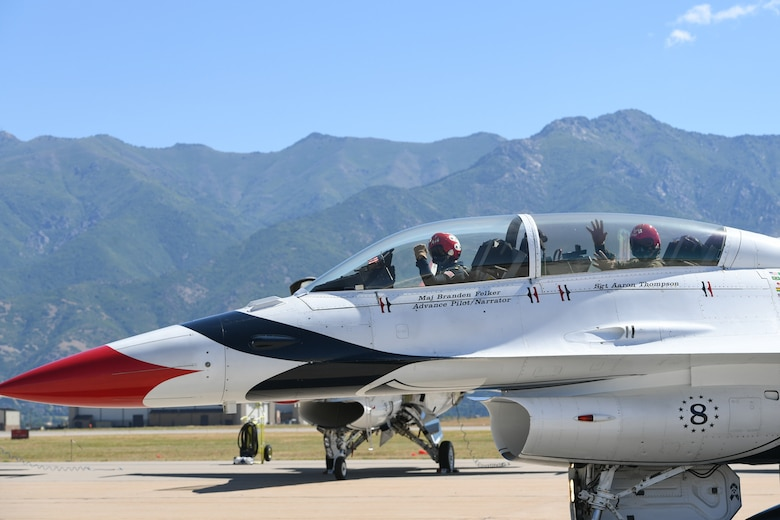 Sergeant Aaron Thompson, Utah Washington County Sheriff, waves at his family and friends before flying with the U.S. Air Force Thunderbirds June 22, 2018, at Hill Air Force Base, Utah. Thompson was selected to fly with the Thunderbirds as part of their Hometown Hero program. (U.S. Air Force photo by Cynthia Griggs)