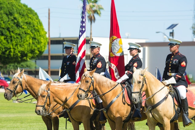 The Marine Corps Mounted Color Guard participates in a retirement ceremony on Marine Corps Air Station Yuma, Ariz., June 22, 2018. The mounted color guard is the only equestrian color guard in the Marine Corps, and is stationed at Marine Corps Logistics Base, Barstow, California. (U.S. Marine Corps photo by Sgt. Allison Lotz)