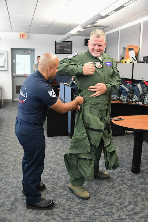 Sergeant Aaron Thompson, Utah Washington County Sheriff, gets fitted for his anti-g suit with the help of  Tech. Sgt. Ed Portan, U.S. Air Force Thunderbirds aircrew flight equipment, June 22, 2018, at Hill Air Force Base, Utah. Thompson was selected to fly with the Thunderbirds as part of their Hometown Hero program. (U.S. Air Force photo by Cynthia Griggs)