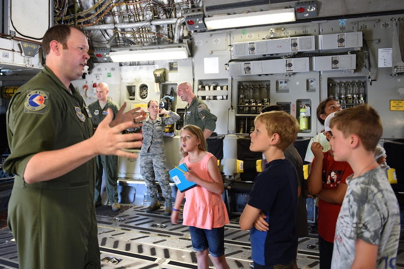 U.S. Air Force Tech. Sgt. Ryan Thompson, loadmaster for the 145th Operations Group, briefs children of North Carolina Air National Guard members as they enter a C-17 Globemaster III aircraft at the N.C. Air National Guard Base, Charlotte-Douglas International Airport, June 18, 2018. The children are part of the annual Department of Defense STARBASE summer camp program and learn various applications of science, technology, engineering and math.