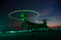 A U.S. Marine MV-22 Osprey with the 22nd Marine Expeditionary Unit lands on the deck of the USS Arlington during Amphibious Squadron-MEU Integration training in the Atlantic Ocean, June 15, 2018. PHIBRON-MEU Integration is a two-week training evolution that allows Sailors and U.S. Marines to train as a cohesive unit in preparation for their upcoming deployment.