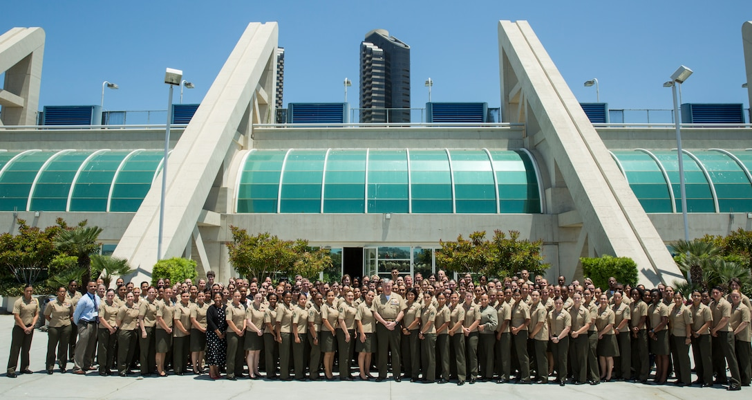 The Assistant Commandant of the Marine Corps Gen. Glenn M. Walters poses for a photo with women attending the 2018 Joint Women's Leadership Symposium, San Diego, Calif., June 22, 2018. JWLS is the largest annual gathering of women in uniform in the nation hosted by the Sea Service Leadership Association, and is dedicated to providing preemient professional development events to women serving in the Department of Defense and Coast Guard.