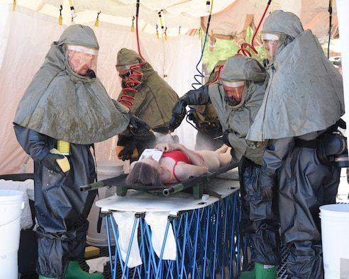 Members of the 161st Air Refueling Wing process a patient through an In-Place Patient Decontamination station during an exercise at the Goldwater Air National Guard Base, May 22, 2018. The purpose of the exercise was to train and evaluate the IPPD team's ability to decontaminate and prepare a patient to be transported onto a higher level of medical care. (U.S. National Guard photo by Staff Sgt. Wes Parrell)