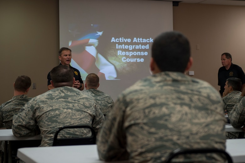 Doug Herrington and Tim Williams, Advanced Law Enforcement Rapid Response Training instructors, teach the classroom portion of their training to first responders of the 97th Air Mobility Wing, June 18, 2018, at Altus Air Force Base, Okla.