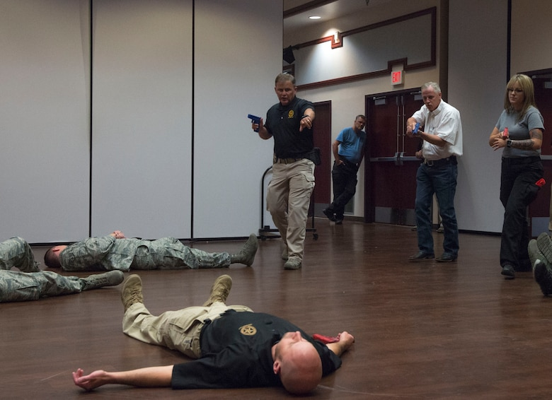 Doug Herrington, Advanced Law Enforcement Rapid Response Training instructor, demonstrates how to take lead in an active shooter response to first responders of the 97th Air Mobility Wing, June 18, 2018, at Altus Air Force Base, Okla.