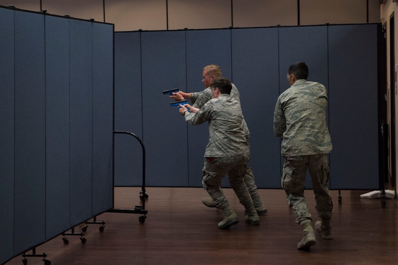 Members of the 97th Security Forces Squadron rush in after they see a suspect of an active shooter situation, during Advanced Law Enforcement Rapid Response Training, June 18, 2018, at Altus Air Force Base, Okla.