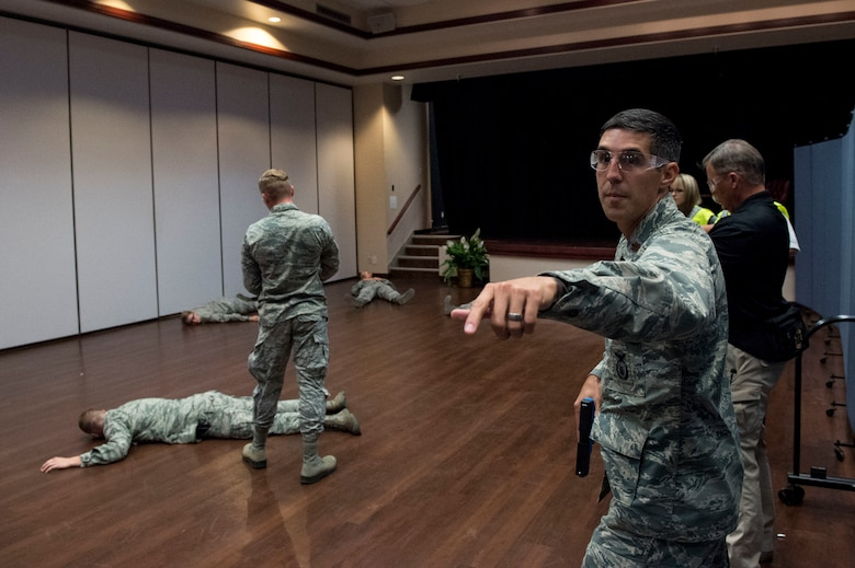 U.S. Air Force Maj. Nathaniel Lesher, commander of the 97th Security Forces Squadron, directs his team members to aid the wounded, during Advanced Law Enforcement Rapid Response Training, June 18, 2018, at Altus Air Force Base, Okla.