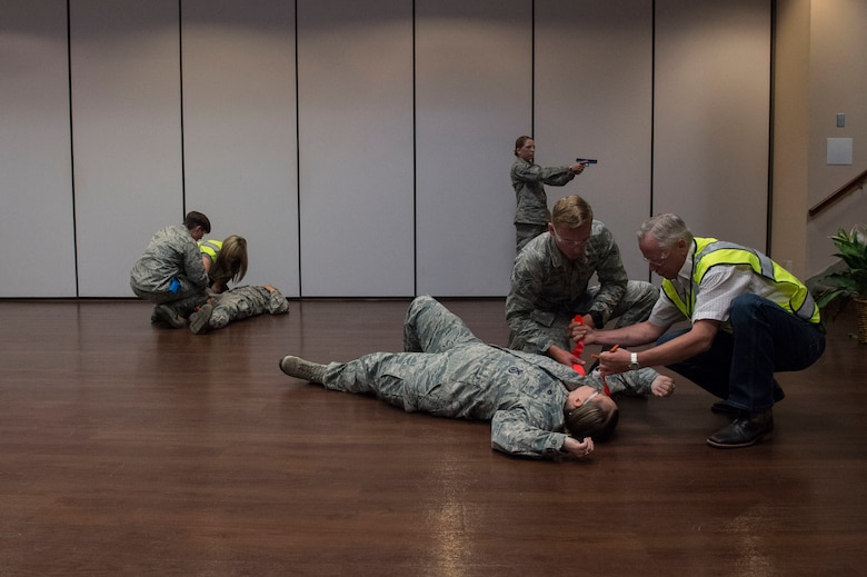 Members of the 97th Security Forces Squadron are assisted by instructors on how to provide medical support to victims while responding to an active shooter, during Advanced Law Enforcement Rapid Response Training, June 18, 2018, at Altus Air Force Base, Okla.