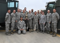 Col. Gretchen M. Wiltse and Col. Douglas Strawbridge stand with members of the 911th Fuels Management Flight on June 1, 2018, at Pittsburgh International Airport Air Reserve Station. The flight won the Golden Derrick award for Best Fuels Management Flight in the Air Force Reserve Command for 2017. Wiltse is the chief of the AFRC Logistics Readiness Division and Strawbride is the commander of the 911th Airlift Wing.