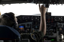 A U.S. Air Force pilot assigned to the 72nd Aircraft Refueling Squadron adjusts a dial on a KC-135R Stratotanker above the Atlantic Ocean, June 19, 2018.