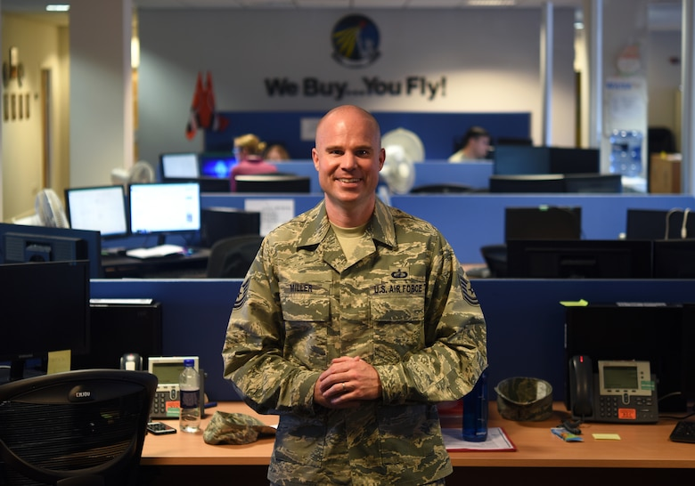 Tech. Sgt. David E. Miller, 48th Contracting Squadron Personnel and Readiness NCO in-charge, poses for a photo at the 48th CONS at Royal Air Force Lakenheath, England, June 25, 2018. Through his outstanding leadership abilities, job performance and personal achievements, Miller earned the illustrious Air Force's Outstanding Airman of the Year award for 2018. (U.S. Air Force photo by Staff Sgt. Alex Fox Echols III)