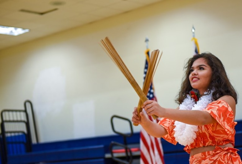 A Polynesian dancer performs for Team Buckley during a Diversity Day event June 22, 2018, at Buckley Air Force Base, Colorado. The Polynesian dancers shared their cultural values with Team Buckley along with various dances that resembled their proud culture. (U. S. Air Force photo by Airman 1st Class Michael Mathews)