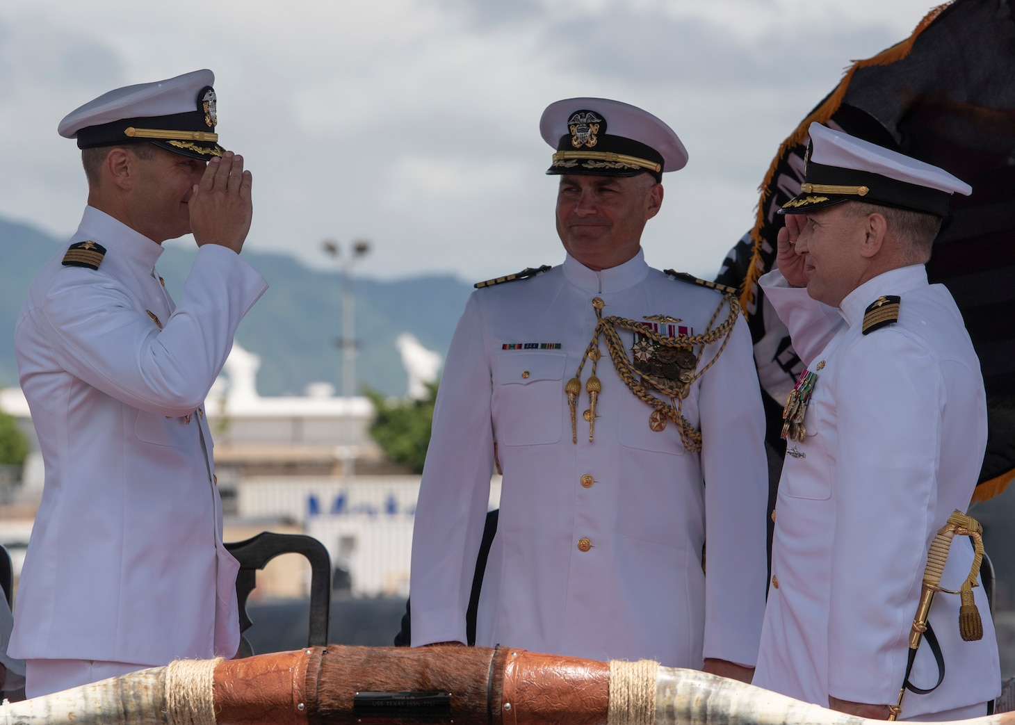 Capt. Paul Davis relieves Capt. Robert A. Roncska as commander of Submarine Squadron 7 during a change of command and retirement ceremony on the submarine piers in Joint Base Pearl Harbor-Hickam, June 22. (U.S. Navy photo by Mass Communication Specialist 2nd Class Michael H. Lee/Released)