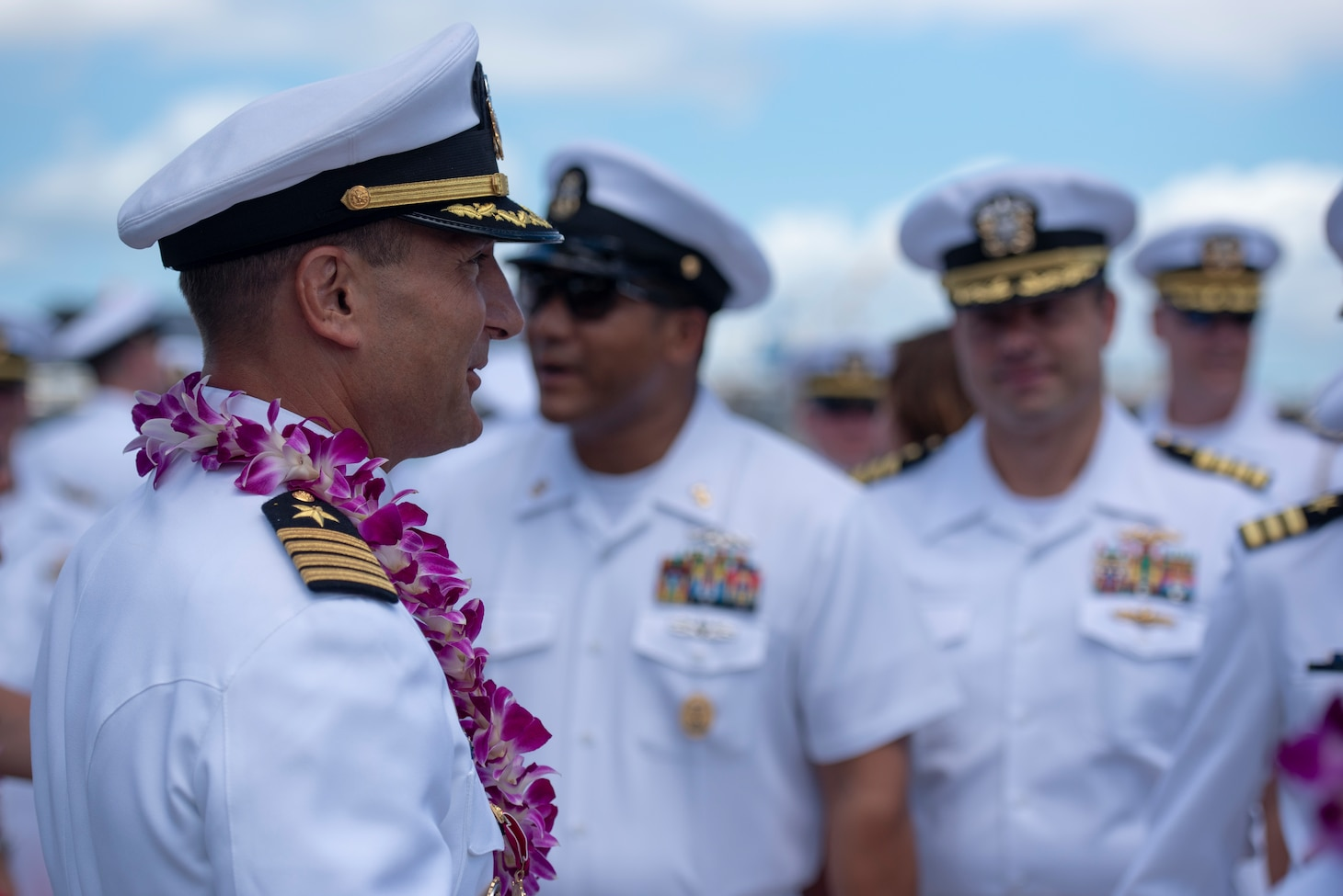 Guests, from the Submarine Squadron 7 change of command and retirement ceremony, bid farewell to Capt. Robert A. Roncska (Ret.) on the submarine piers in Joint Base Pearl Harbor-Hickam, June 22. (U.S. Navy photo by Mass Communication Specialist 2nd Class Michael H. Lee/Released)
