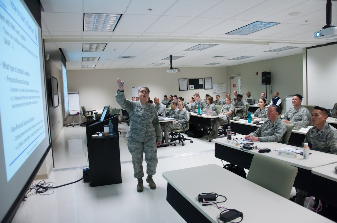 Capt. Marina Boles, Health Services Administration Medical Readiness Management course instructor, Joint Base San Antonio, Fort Sam Houston, conducts a training session during the second pilot of the Basic Leader Airman Skills Training course, held at the United States Air Force School of Aerospace Medicine at Wright-Patterson Air Force Base, Ohio May 24, 2018.
