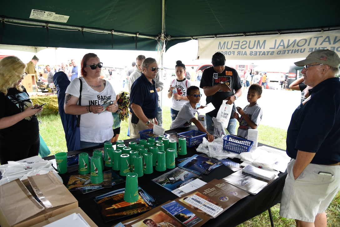 Air show fans visit the National Museum of the USAF booth at the Vectren Dayton Air Show on June 23, 2018.  (U.S. Air Force photo by Ken LaRock)