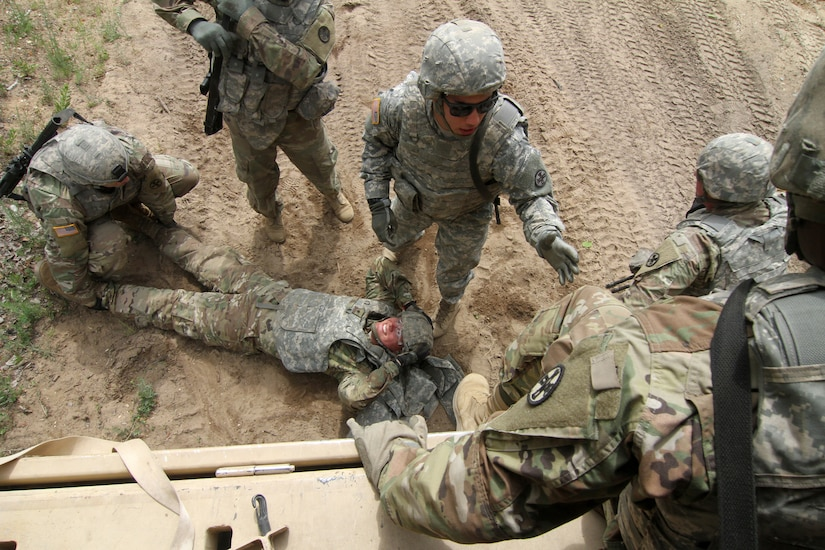 Soldiers prepare to evacuate a simulated casualty.