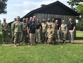 From left: Navy Cmdr. Jody Daniel, Navy Cmdr. Michael Wanger, Navy Lt. Cmdr. David Muhl, Navy Petty Officer 2nd Class Andray Newkirk, Tom Couch, John Foden, Adrienne Smith, Tim Fahey, Tim Collins, Air Force Master Sgt. Edward Johnson, Army Col. Andrea McCollum, Army Maj. Christopher Price, Army Capt. Mihkel Angelo, Army Lt. Col. Edward Brown, Andrew Vickers, Air Force Master Sgt. Christopher Miller and Tim Mark. (Photo by Navy Logistics Specialist 2nd Class Vincent Smith)