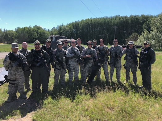Five members of the Ohio Department of Rehabilitation and Correction's Special Tactics and Response Team partner with 178th Wing Security Forces Squadron to conduct training at the Alpena Combat Readiness Training Center, Mich., June 11-15, 2018. STAR instructors trained Airmen in less-than lethal weapons tactics, riot control, active shooter response, building clearing and personnel tracking.