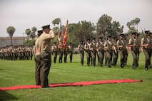 U.S. Marines with 7th Engineer Support Battalion, 1st Marine Logistics Group, conduct a pass and review during a change of command ceremony at Camp Pendleton, Calif., June 21, 2018. Lieutenant Colonel Jennifer Nash relinquished her duties to Lt. Col. Evan Day, who will now serve as the commanding officer for 7th ESB. (U.S. Marine Corps photo by Lance Cpl. Quentarius Johnson)