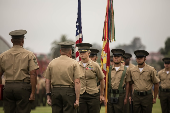 U.S. Marine Lt. Col. Jennifer Nash, the off-going commanding officer for 7th Engineer Support Battalion, 1st Marine Logistics Group, is awarded with the Meritorious Service Medal during a change of command ceremony at Camp Pendleton, Calif., June 21, 2018. The Meritorious Service Medal is awarded to those who distinguish themselves by outstanding meritorious achievement during service. (U.S. Marine Corps photo by Lance Cpl. Quentarius Johnson)