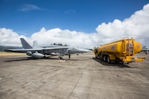 U.S. Marines with Marine All-Weather Fighter Attack Squadron 533 refuel a F/A-18 Hornet aircraft, Marine Corps Air Station Kaneohe Bay, Marine Corps Base Hawaii (MCBH), June 22, 2018. The squadron is currently aboard MCBH to support Exercise Rim of the Pacific 2018. (U.S. Marine Corps photo by Lance Cpl. Isabelo Tabanguil)