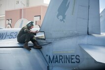 A U.S. Marine with Marine All-Weather Fighter Attack Squadron 533 performs maintenance on a F/A-18 Hornet aircraft, Marine Corps Air Station Kaneohe Bay, Marine Corps Base Hawaii (MCBH), June 22, 2018. The squadron is currently aboard MCBH to support Exercise Rim of the Pacific 2018. (U.S. Marine Corps photo by Lance Cpl. Isabelo Tabanguil)
