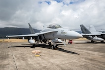 A F/A-18 Hornet aircraft assigned to Marine All-Weather Fighter Attack Squadron 533 sits at Hangar 105, Marine Corps Air Station Kaneohe Bay, Marine Corps Base Hawaii, June 22, 2018. The squadron is currently aboard MCBH to support Exercise Rim of the Pacific 2018. (U.S. Marine Corps photo by Lance Cpl. Isabelo Tabanguil)