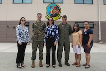 Paloma Almanza (center), the principal for Mokapu Elementary School, poses for a group photo at the Marine Medium Tiltrotor Squadron 268 hangar, Marine Corps Base Hawaii, June 22, 2018. Almanza was provided a guided tour of Marine Corps Air Station Kaneohe Bay to familiarize and welcome her to the base. (U.S. Marine Corps photo by Sgt. Jesus Sepulveda Torres)